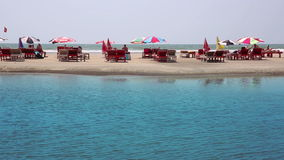 Holiday resort on water's edge. Idyllic holiday resort on sandy beach by the sea stock video