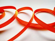 Holiday ribbon close up on white background royalty free stock photography