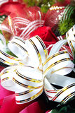 Holiday ribbon on the flower Royalty Free Stock Photography