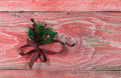 Holiday ribbon on rustic red wooden boards Royalty Free Stock Images