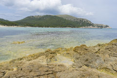 Holiday, Rocks by the sea with waves of the Mediterranean sea ne Royalty Free Stock Images