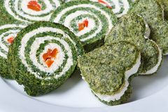 Holiday rolls and cookies spinach on a plate closeup horizontal Royalty Free Stock Image