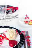 Holiday romantic table setting with pink roses. On a white background stock photo