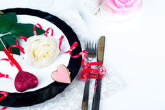 Holiday romantic table setting with pink roses. On a white background stock photos