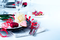 Holiday romantic table setting with pink roses. On a white background royalty free stock photo