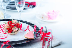 Holiday romantic table setting with pink roses. On a white background royalty free stock photography