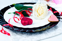 Holiday romantic table setting with pink roses Stock Photos
