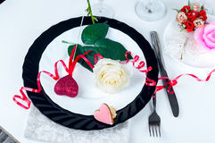 Holiday romantic table setting with pink roses. On a white background stock images