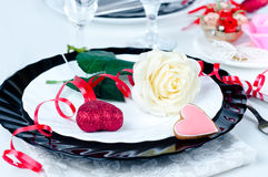 Holiday romantic table setting with pink roses. On a white background royalty free stock image