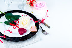 Holiday romantic table setting with pink roses. On a white background royalty free stock photos