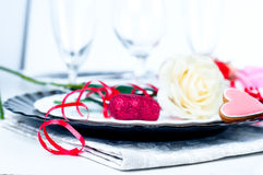 Holiday romantic table setting with pink roses Stock Photography