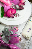Holiday romantic table setting with pink roses on a white background Royalty Free Stock Photos