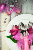 Holiday romantic table setting with pink roses on a white background Stock Images