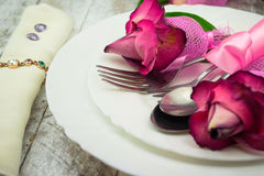 Holiday romantic table setting with pink roses on a white background Royalty Free Stock Images