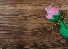 Holiday/romantic/valentine Day background with plush rose and gift box on wooden table. There is a place to write the text Stock Image