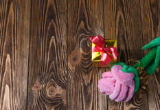 Holiday/romantic/valentine Day background with plush rose and gift box on wooden table. There is a place to write the text Stock Photo
