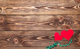 Holiday/romantic/wedding/valentine Day background with two paper hearts and ribbon. Stock Photo