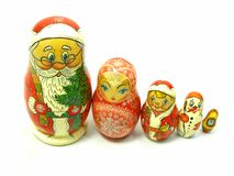 Holiday Russian Nesting Dolls. Russian nesting dolls with a holiday theme - including Santa, snowflake, bell ringer, snowman and New Year's Eve clock Stock Photos