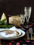 Holiday rustic Christmas and New Year table setting with xmas decorations at dark wooden table. copy space. Royalty Free Stock Photo