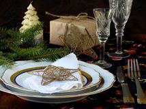 Holiday rustic Christmas and New Year table setting with xmas decorations at dark wooden table. Stock Image