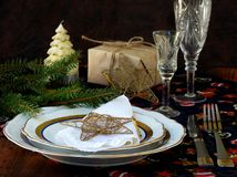 Holiday rustic Christmas and New Year table setting with xmas decorations at dark wooden table. Royalty Free Stock Photos