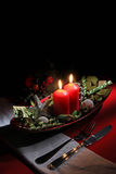 Holiday rustic Christmas and New Year table setting with xmas decorations at dark wooden table. Selective focus Royalty Free Stock Images