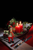 Holiday rustic Christmas and New Year table setting with xmas decorations at dark wooden table. Selective focus Stock Image