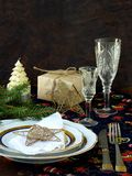 Holiday rustic Christmas and New Year table setting with xmas decorations at dark wooden table. Selective focus, Stock Photos