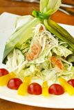 Holiday salad with crab, shrimp and vegetables in leek leaf Royalty Free Stock Image