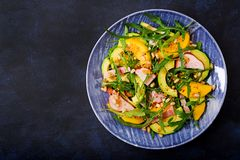 Holiday salad with smoked chicken, mango, avocado and arugula. Stock Images