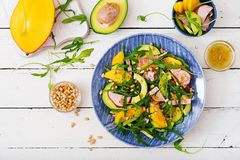 Holiday salad with smoked chicken, mango, avocado and arugula. Royalty Free Stock Images