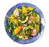 Holiday salad with smoked chicken, mango, avocado and arugula Stock Photography