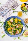 Holiday salad with smoked chicken, mango, avocado and arugula. Stock Image