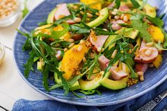 Holiday salad with smoked chicken, mango, avocado Stock Photos