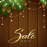 Holiday sale and Christmas decorations on brown wooden backgroun Royalty Free Stock Images
