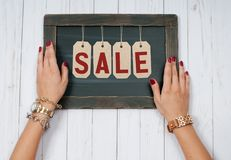 Holiday Sale. Female hands with jewelry. Fashion accessories. Wrist watches, glamor bracelets royalty free stock images