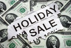 Holiday on sale signs with some $2 dollar bills Royalty Free Stock Image