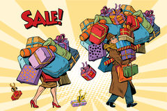Holiday sales, a couple man and woman with shopping Royalty Free Stock Photo