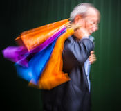 Holiday sales. An elderly man with many shopping bags in his han Royalty Free Stock Images