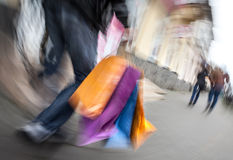 Holiday sales. An elderly man with many shopping bags in his han Stock Photography