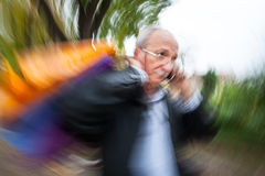 Holiday sales. An elderly man with many shopping bags in his han Stock Photos