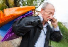Holiday sales. An elderly man with many shopping bags in his han Royalty Free Stock Photography