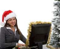 Holiday Sales Support. Young woman in santa hat and phone headpiece doing holiday sales calls Stock Images