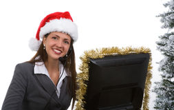 Holiday Sales Support. Young woman in santa hat and phone headpiece doing holiday sales calls Stock Photo