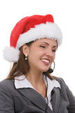 Holiday Sales Support. Young woman in santa hat and phone headpiece doing holiday sales calls Stock Image