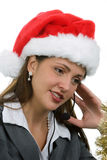 Holiday Sales Support. Young woman in santa hat and phone headpiece doing holiday sales calls Royalty Free Stock Photography