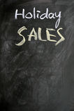 Holiday sales written on a blackboard royalty free stock photo