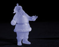 Holiday Santa. Frosted Santa ornament with blue Stock Photos