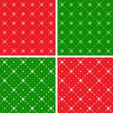 Holiday seamless ornaments. Seamless patterns. Christmas ornaments with snowflake and dotted rhombuses. Holiday backgrounds Royalty Free Stock Image