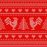 Holiday seamless pattern with cross stitch embroidered roosters Royalty Free Stock Photo